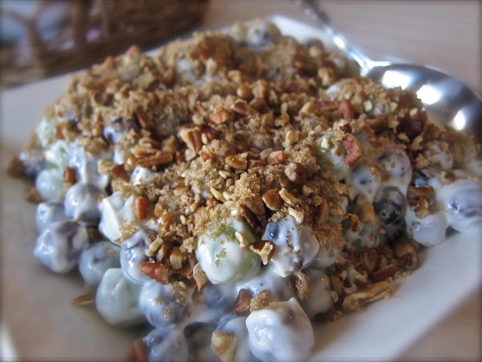 stir cream cheese mixture with the grapes and place in a serving dish