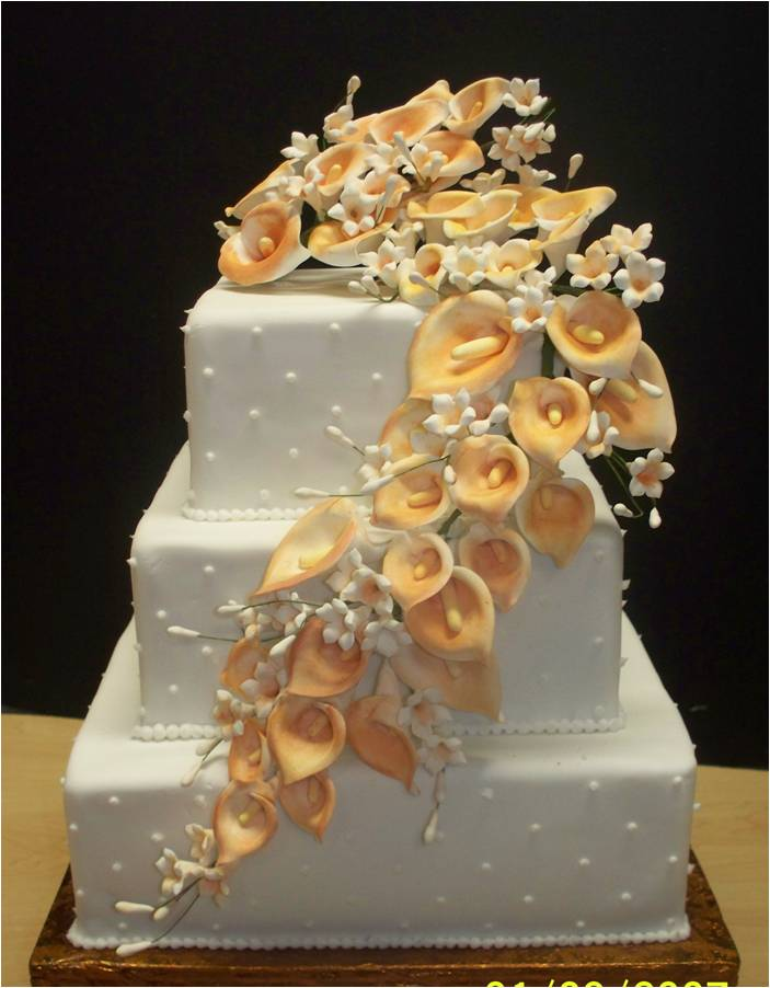 The wedding cake will look astonishing with some colorful calla lilies on it