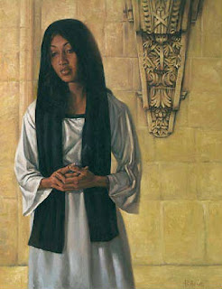 portrait of dark skinned woman with waist length black hair in front of a sandstone wall