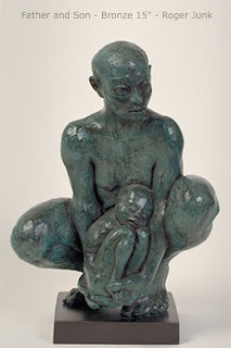 sculpture of squatting father cradling young son