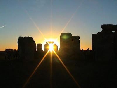 sun rising on solstice over stonehenge