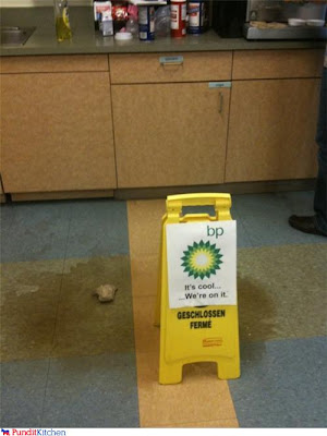 wet floor sign over coffee spill with the words BP we're on it