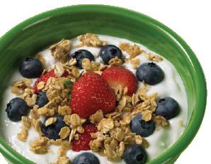 A bowl of cereal complete with milk and fruits.