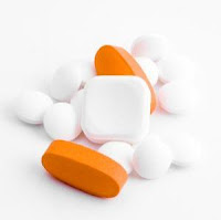 White and orange pills.