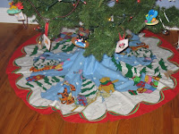 this beautiful tree skirt that my friend kim made me i found it preprinted on ebay and just knew i needed this to finish out my disney christmas tree - Disney Christmas Tree Skirt