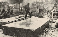 A worker uses a special burner to finish a slab of Pyramid Blue granite. Photo: Courtesy of Fendley Enterprises Inc.