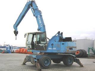 2 795171 EXCAVATOR INDUSTRIAL Fuchs MHL320 pentru depozite fier vechi second hand 2000 57.900 Euro