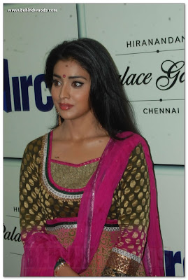 Shriya Saran is in red and green dress