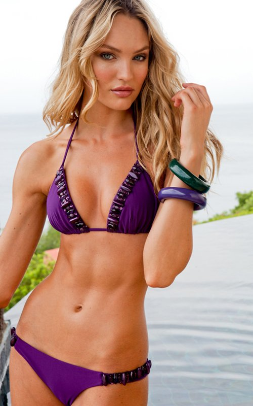 Candice Swanepoel posing for Savage Swimwear