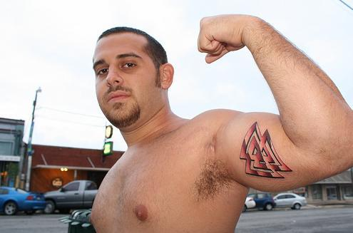 "Brandon- ""Fraternity symbol on a dude's bicep. This tattoo was a workout but"