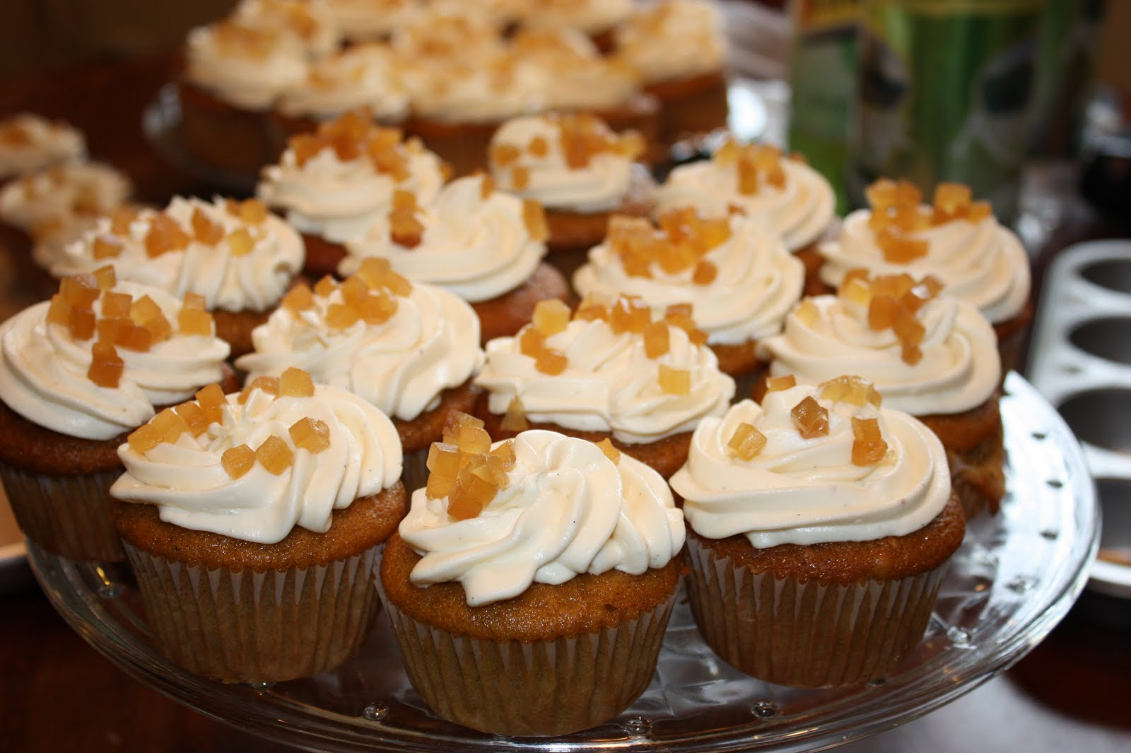 Pumpkin cupcakes with cream cheese frosting and ginger jelly.