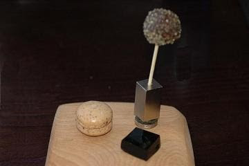 Petit fours: Malt macaroon with cream filling, mint cake and dark chocolate lollipop and red grape and raisin Turkish delight
