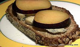 Toasted open sandwich of sliced California plum and Boucher Blue cheese