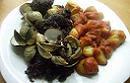 Classical Spanish cooking - butifarra y berberechos con patatas bravas