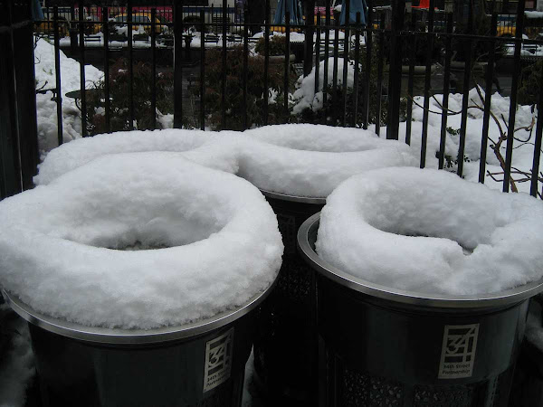 Snow Cuffs - On garbage cans at Herald Square.