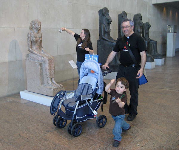 Tourist Whirlwind - Friends from out of town fly through the Egyptian wing at the Metropolitan Museum.