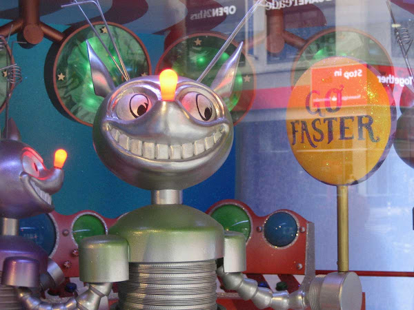 Go Faster! - Evil elf-bot sums up Our Times in Macy's 2009 holiday windows.