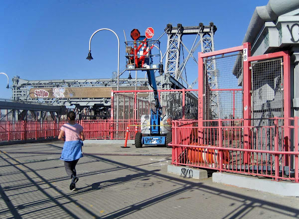 Matching Bridge - A jogger matches not just the Williamsburg Bridge, but the maintenance equipment too.