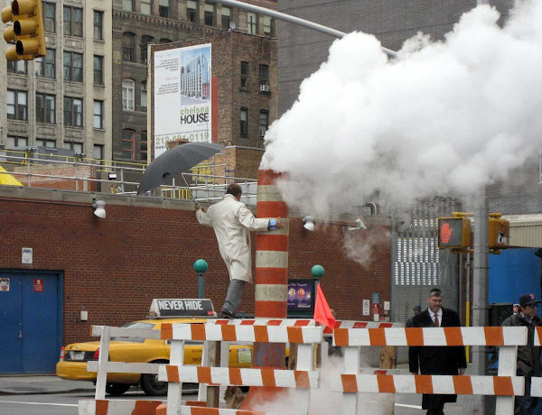 Steam Vent Photo Shoot - Not my photo shoot; I saw the guy climb up, then noticed he was posing. On 7th Ave. at 18th St.