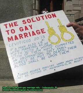 sign calling for death penalty for gays, citing Leviticus 20:13, showing too nooses