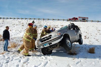 Powell volunteer firefighters work to right a wrecked car