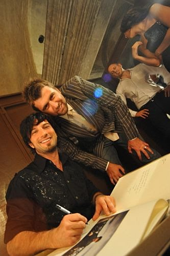 Turkish professional NBA basketball player Mehmet Okur with Tarkan
