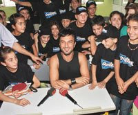 Tarkan visits children at school