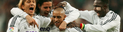 Team'mates congratulate Roberto Carlos after scoring the winner