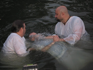 Dr. Yates getting baptized