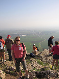 Elke on top of Mount Precipice with the Jezreel Valley below her
