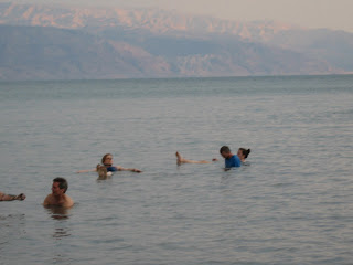 Floating in the Dead Sea with the Jordanian mountains in the background