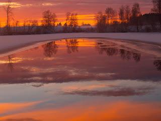 Solnedgang i råka