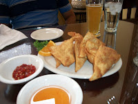 Click to enlarge - Appetizer is crispy wontons filled with port and veggies