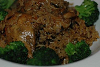 Two-day marinaded brown stew chicken and wild rice with sesame sautéed broccoli