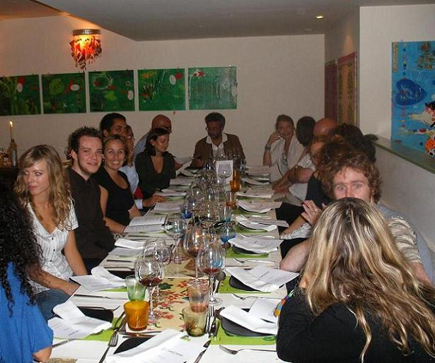 "A very Italian style of eating - everyone packed closely together round the ""family"" table"