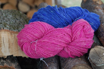 Blue and pink handspun yarn on the woodpile