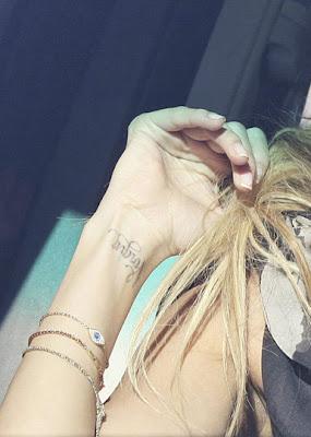 bow tattoos on wrist
