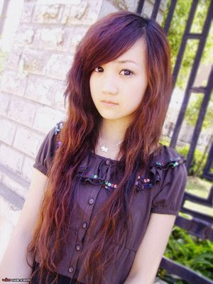 cute sweet Asian girl with straight bangs and brown hair dye