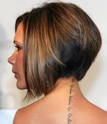 of her neck The tattoo is in Hebrew and is from the Song of Solomon 6:3.
