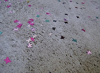 butterfly confetti on the footpath