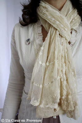 A scarf made with a piece of ecru tulle embroidered