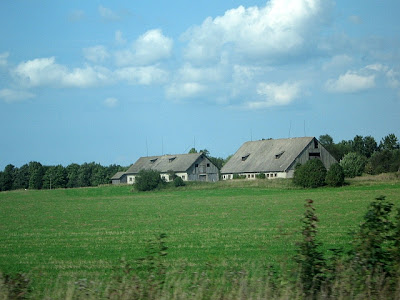 farm buildings in Estonia surrounded by paddock