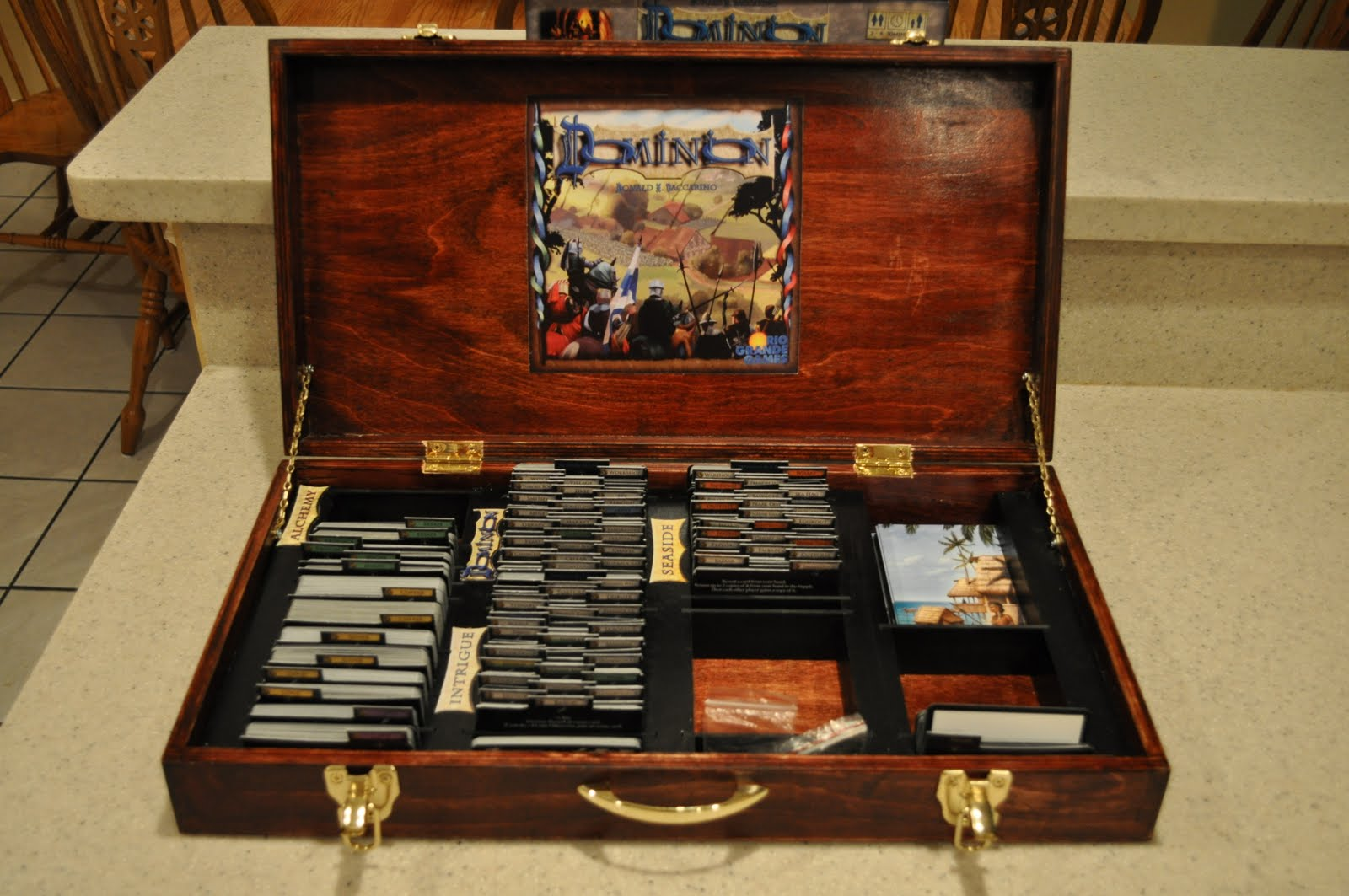 Adventures in board gaming dominion never looked so good and sexy furniture craftsman and bgg member wade ashton recently debuted his treasure chest inspired wooden dominion case as a prototype the case features wooden pronofoot35fo Choice Image