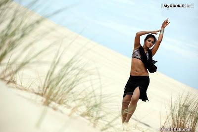 Neetu Chandra in a Bikini Top in a Desert image