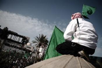 A Palestinian supporter of Hamas takes part in a demonstration outside the destroyed parliament building in Gaza City