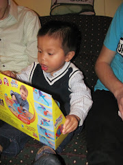 Alexandre opening his Xmas gift