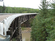 Original curved wooden bridge on old Alcan