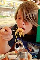 Zane enjoys his slippery spaghetti