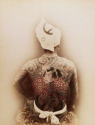 A Japanese man's back full of big Japanese warrior tattoo.