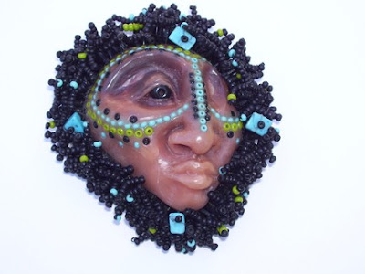 polymer clay face brooch